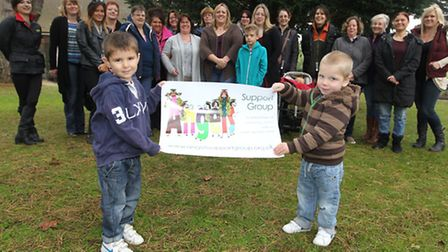 Jake Hall and Junior Houchen hold the Angels support group poster