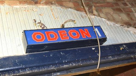 An old Odeon sign above a doorway