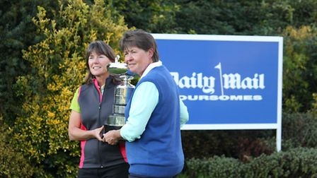 Elaine Meagher, left, and Linda Reeve with the trophy.