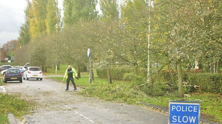 A police officer clearing the road in Parkway, Welwyn Garden City, on Monday morning