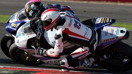 Royston motorbike racer Luke Mossey (white) in action. Pictures by NIGEL SHEARING
