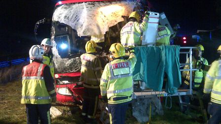 Firefighters at the scene of the coach crash on the A1
