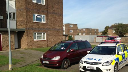 Police at the scene of the stabbing in the block of flats in Dukes Road, Eaton Socon today (Monday)
