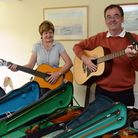 Rotarians Moira Penney and Adrian Acton with just some of the donated instruments