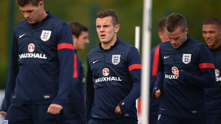 ST ALBANS, ENGLAND - OCTOBER 10: Steven Gerrard, Jack Wilshere and Tom Cleverley warm up during the
