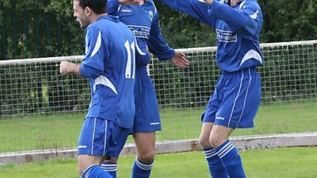 Greg Shaw, middle, celebrates opening the scoring for London Colney against St Margaretsbury. pictur