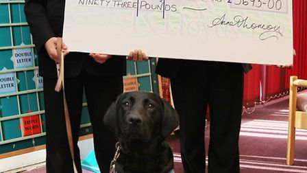 Dylan Lamb and Ibrahim Islam with Biscuit the guide dog as they present a cheque for nearly £4000 to