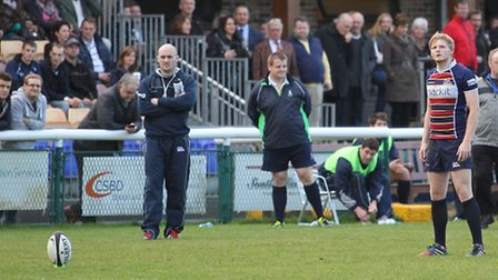 Rayner lines up a kick as the bench watches