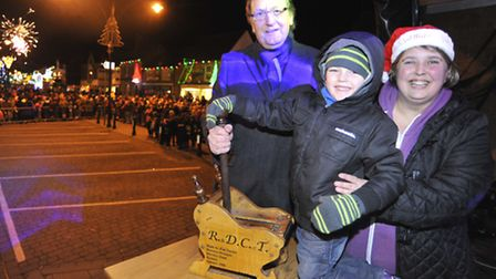 Ramsey Christmas Lights Switch On, (l-r) from RAdio Cambridgeshire Andy Harper, competition winner O