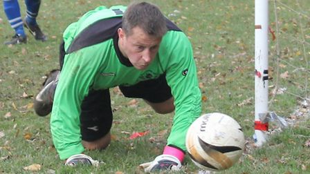 Brookmans Park keeper Keith Harland making one his many saves against PSV.