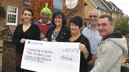 Charity Bungee Jumpers handover a cheque at The Seven Wives Pub, St Ives (back l-r) Kat Herrick and