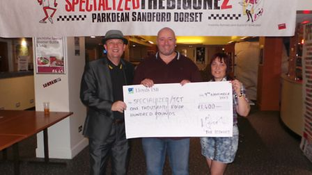 Mike Busby, Tracey Collier, chief fundraiser for the Iconics, and Willo at a recent charity fundrais