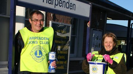 David Cowan (left) and Linda Shall taking their turn with collecting money for the typhoon Haiyan em