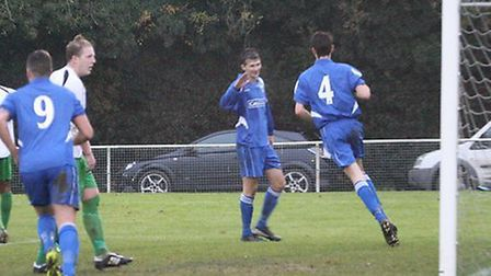 Tom Smith (4) wheels after a heading the winning goal. Picture: James Whittamore