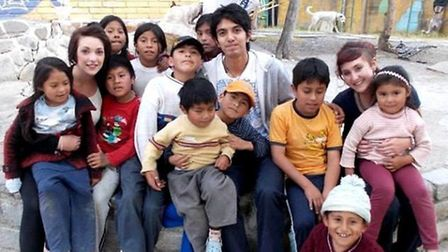 Sophie Greenwood (right) with other volunteers and the children she worked with in Bolivia