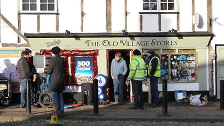 A film crew outside The Old Village Stores in Sandridge during filming for a christmas National Lott