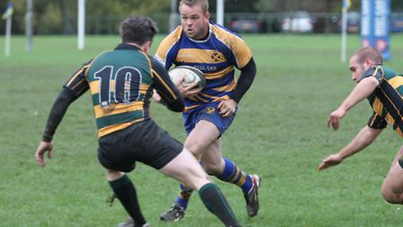 Brenton Lemiere runs at the Old Priorian defence