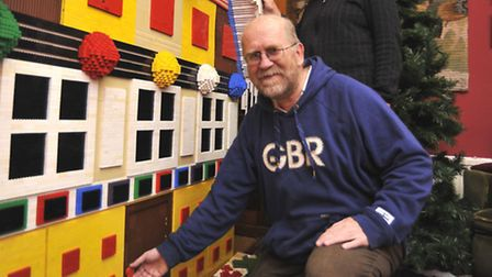 At their home in Huntingdon are Lego desginers (l-r) Mike Addis and his wife Catherine Weightman.