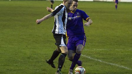 Jared Cunniff challenges for the ball against Slough Town. Picture: Louise Thompson.