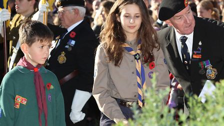 Two scouts approach the war memorial