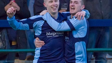 Young but the team's longest serving player, Lewis Hilliard, left, celebrates his goal which gave St