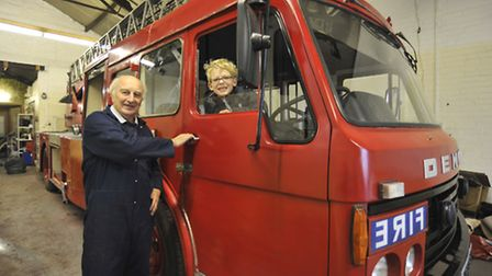 John Sutcliffe with grandson Oliver Missen and the 1970's fire engine he restored