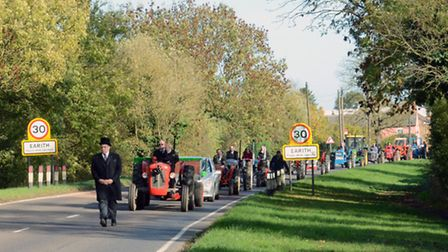 The line of tractors makes its way to Bluntisham church, led by Reg Clements' son Neville