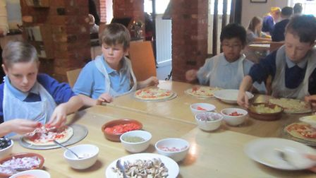 Roysia school pupils carefully select their toppings