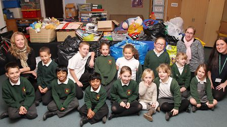 Volunteers Annabelle Beeson, Tanya Rickard and Louise Calder with pupils of Bowmansgreen Primary Sch