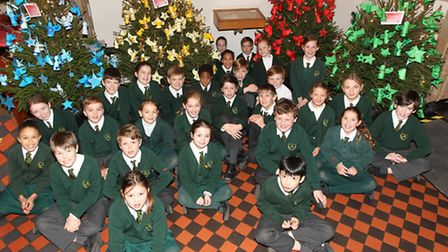 The children of St Nicholas CE Primary School with the trees they have decorated for the christmas t