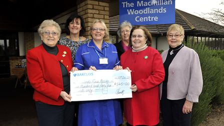 At The Woodlands Centre, with a cheque for £ 545 are (l-r) Phyllis Brooks, Woodlands Administrator K