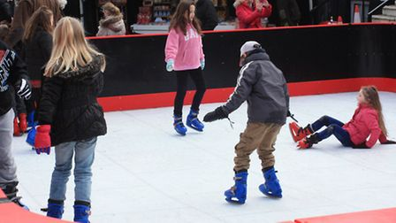 Families enjoy the ice rink at Royston Christmas Fayre