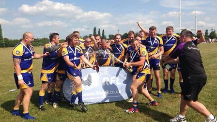 St Ives Roosters celebrate their win in the final of the East of England Sheild.