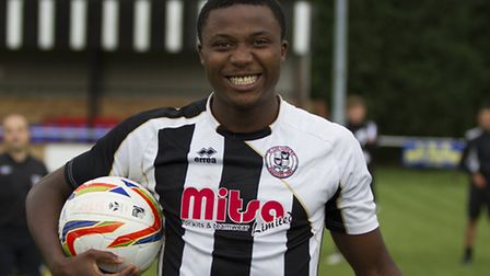 St Ives Town striker Dubi Ogbonna with the match ball after scoring his FA Cup hat-trick.
