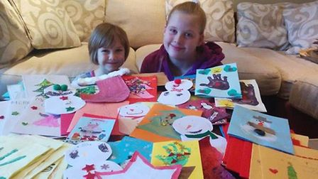 Emma and Hannah with some of the cards that have been made