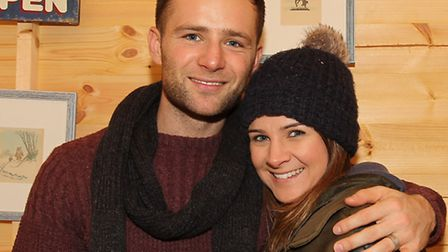 Harry Judd with his wife Izzy on her stall, Izzy's Attic in the St Albans Christmas market