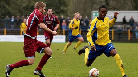 Jamal Lowe looking for away past Mark Lambert. Picture: Leigh Page