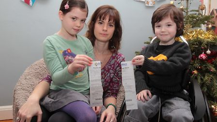 Renata with her son Dominic and daughter Lilia with their parking ticket ripped in half