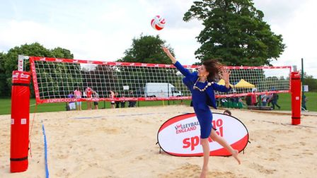 Masyor trying out beach volleyball