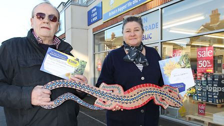 Workshop owner Tony Williamson stands with winner Patricia Ziegelmeier outside Topps Tiles and her w