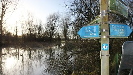 A flooded River Ver off Drop Lane in Smug Oak covers over the stepping stones which are normally vis