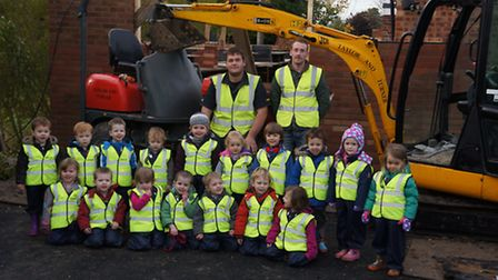 Members of Bumpkins nursery with the builders who are working on their new class-room