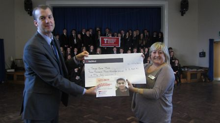 Principal Duncan Cooper handing the cheque over to Judith Anderson from the Trust
