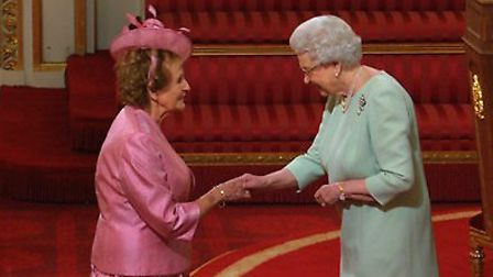 The Queen with Dr Mary Groves (Rowe) of St Albans, who received her MBE at the investiture at Buckin
