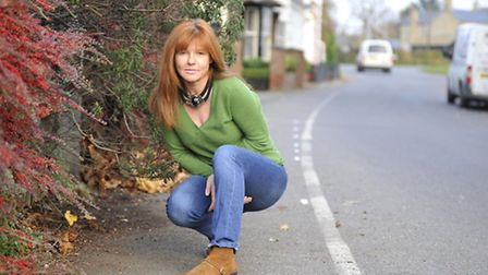 Fenstanton resident Dolores O'Reilly next to the marked out footpath