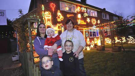 At High Leys, St Ives, are the christmas lights to raise money for Magpas, organisers (l-r) Sarah Bu