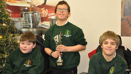 Jabe Peake, James Orrell and Tom Mayers of the victorious Hinchingbrooke team wear their winners med