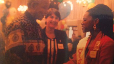 Claire Farley (centre) with Nelson Mandela
