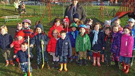 Deputy Mayor of St Albans Brian Gibbard stands in East Common Playground in Redbourn with local chil