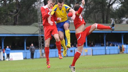 Ben Martin wins a header against two Frome Town defenders. Picture: Bob Walkley